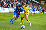 Gillingham forward Joe Quigley (17) and Bristol Rovers defender Jake Clarke-Salter (36) during the EFL Sky Bet League 1 match between Gillingham and Bristol Rovers at the MEMS Priestfield Stadium, Gillingham, England on 14 April 2017. Photo by Martin Cole.