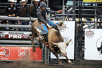 Magic Time gives rider Nick Volden a run for his money in the second round of Wednesday's 2013 PBR Touring Pro Division event at the Salinas Sports Complex.
