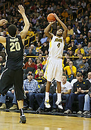 February 27 2013: Iowa Hawkeyes guard/forward Roy Devyn Marble (4) puts up a shot over Purdue Boilermakers center A.J. Hammons (20) during the first half of the NCAA basketball game between the Purdue Boilermakers and the Iowa Hawkeyes at Carver-Hawkeye Arena in Iowa City, Iowa on Wednesday, February 27 2013.