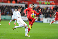 Swansea's Pablo Hernandez is challenged by Stewart Downing of Liverpool. Barclays Premier league, Swansea city v Liverpool at the Liberty Stadium in Swansea , South Wales on Sunday 25th November 2012. pic by Andrew Orchard, Andrew Orchard sports photography,