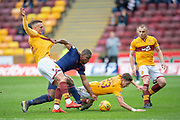 Uche Ikpeazu (#19) of Heart of Midlothian is surrounded by Tom Aldred (#5) Alex Rodreguez Gorrin (#23) and Liam Grimshaw (#14) of Motherwell FC during the Ladbrokes Scottish Premiership match between Motherwell FC and Heart of Midlothian FC at Fir Park, Stadium, Motherwell, Scotland on 17 February 2019.