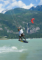 "Kite surfers on the Howe Sound near ""The Spit"" in Squamish, BC, Canada. Shannon Falls in the background."