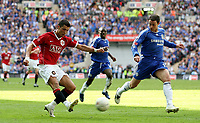 Photo: Paul Thomas.<br /> Chelsea v Manchester United. The FA Cup Final. 19/05/2007.<br /> <br /> Cristiano Ronaldo (Red) of Utd crosses in-front of Wayne Bridge.