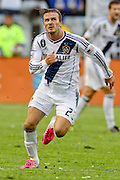 01.DECEMBER.2012. LOS ANGELES<br /> <br /> DAVID BECKHAM ENDS HIS LOS ANGELES GALAXY CAREER WITH A VICTORY IN THE MLS CUP. THE ENGLISH FOOTBALLER ENDED THE PLAYING PART OF HIS AMERICAN ADVENTURE WITH A SECOND CONSECUTIVE MLS CUP, AS LA GALAXY BEAT HOUSTON DYNAMO 3-1.<br /> <br /> BYLINE: EDBIMAGEARCHIVE.CO.UK<br /> <br /> *THIS IMAGE IS STRICTLY FOR UK NEWSPAPERS AND MAGAZINES ONLY*<br /> *FOR WORLD WIDE SALES AND WEB USE PLEASE CONTACT EDBIMAGEARCHIVE - 0208 954 5968*