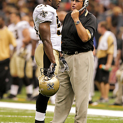 2009 August 14: Saints defensive coordinator Gregg Williams talks to linebacker Jonathan Vilma (51) on the field during a preseason opener between the Cincinnati Bengals and the New Orleans Saints at the Louisiana Superdome in New Orleans, Louisiana.