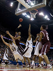 Virginia Tech Hokies forward Deron Washington (13) shoots over Southern Illinois Salukis forward Tony Boyle (35).  The #4 seed Southern Illinois Salukis defeated the #5 seed Virginia Tech Hokies 63-48 in the second round of the Men's NCAA Basketball Tournament at the Nationwide Arena in Columbus, OH on March 18, 2007.