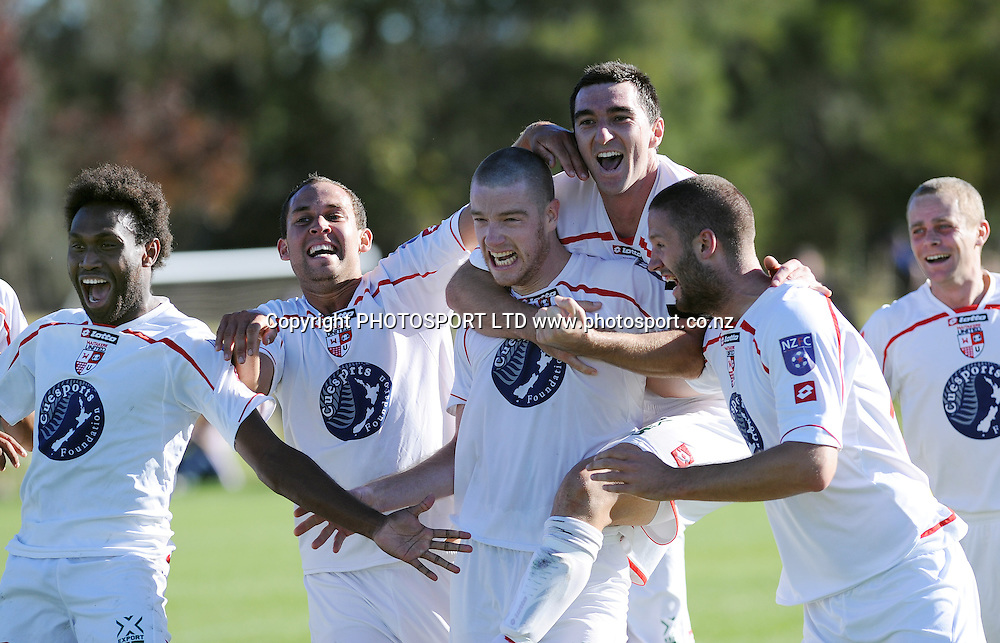 Waitakere's Brent Fisher celebrates with team mates after scoring a goal in the final minute to qualify for the final.NZFC Semi Final, Waitakere United v Team Wellington, Fred Taylor Park, Auckland<br />