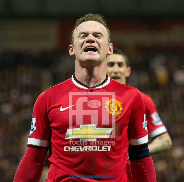 Wayne Rooney of Manchester United celebrates after scoring his team's 3rd goal to make it 3-1 during the FA Cup match at Deepdale, Preston<br /> Picture by Russell Hart/Focus Images Ltd 07791 688 420<br /> 16/02/2015