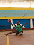 Claudine Bazubagira playing sit ball. Claudine is a member of the National Paralympic Committee (NPC). NPC works with disabled people and sport throughout Rwanda, from grass roots to international level, using sport as a means of social integration.