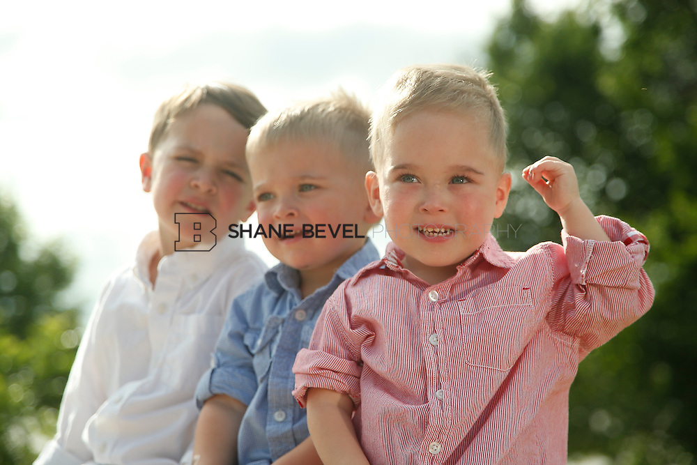 5/28/15 5:38:43 PM -- Miracle Miles and his family pose for portraits and play at the QuikTrip park for the 2015 Saint Francis Health System advertising campaign. <br /> <br /> Photo by Shane Bevel