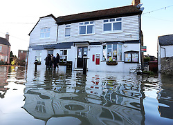 Boxing Day floods.. Residents in Yalding, Kent,  survey the scene in their flooded village as they brace themselves for the possibility of  more flooding with another storm on the way, Thursday, 26th December 2013. Picture by Stephen Lock / i-Images