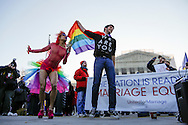 Gay marriage proponents dance on the plaza at the U.S. Supreme Court in Washington.