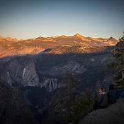 Visitors watch sunset in this view from Glacier Point inside Yosemite National Park on Sunday, September 22, 2019 in Yosemite, California. (Alex Menendez via AP)