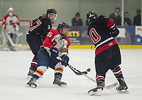 Harrison Parent of Belmont-Gilford tries to gain control of the puck challenged by Noah Schoenbeck of Berlin during NHIAA Division III semi final hockey at Plymouth State University on Wednesday evening.  (Karen Bobotas/for the Laconia Daily Sun)