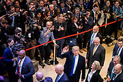 A huge crowd of media and onlookers gather to see the US President Doanld Trump arrive at the World Economic Forum in Davos along with his entourage.