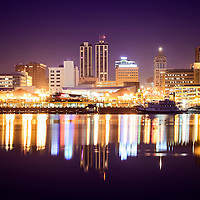 Picture of Peoria Illinois at night downtown city skyline buildings reflection on the Illinois River and the Spirit of Peoria paddlewheel riverboat.