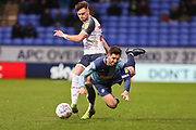 Bolton Wanderers midfielder Dennis Politic fouls Wycombe Wanderers defender Joe Jacobson during the EFL Sky Bet League 1 match between Bolton Wanderers and Wycombe Wanderers at the University of  Bolton Stadium, Bolton, England on 15 February 2020.