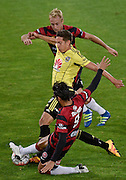 Alex Rodriguez (C of the Phoenix fights for possession with West Sydney's Dimas Delgado (Bottom) and Mitch Nichols during the A-League - Wellington Phoenix v Western Sydney football match at Westpac Stadium in Wellington on Sunday the 10 April 2016. Copyright Photo by Marty Melville / www.Photosport.nz