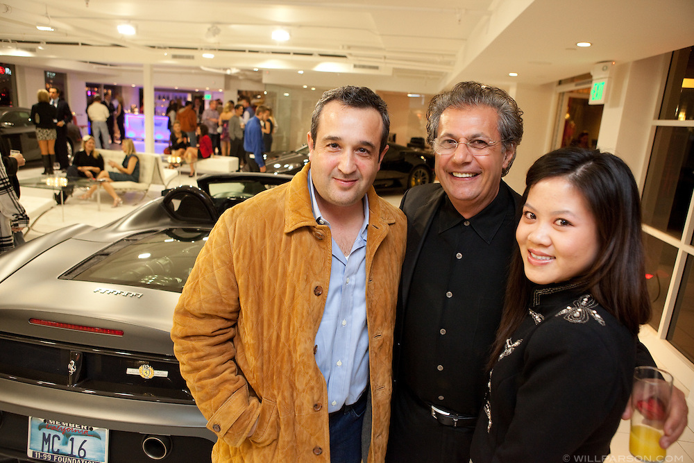 Armando Flores, director of Ferrari Owner's Club, with David Bahran and Tracy Chai.