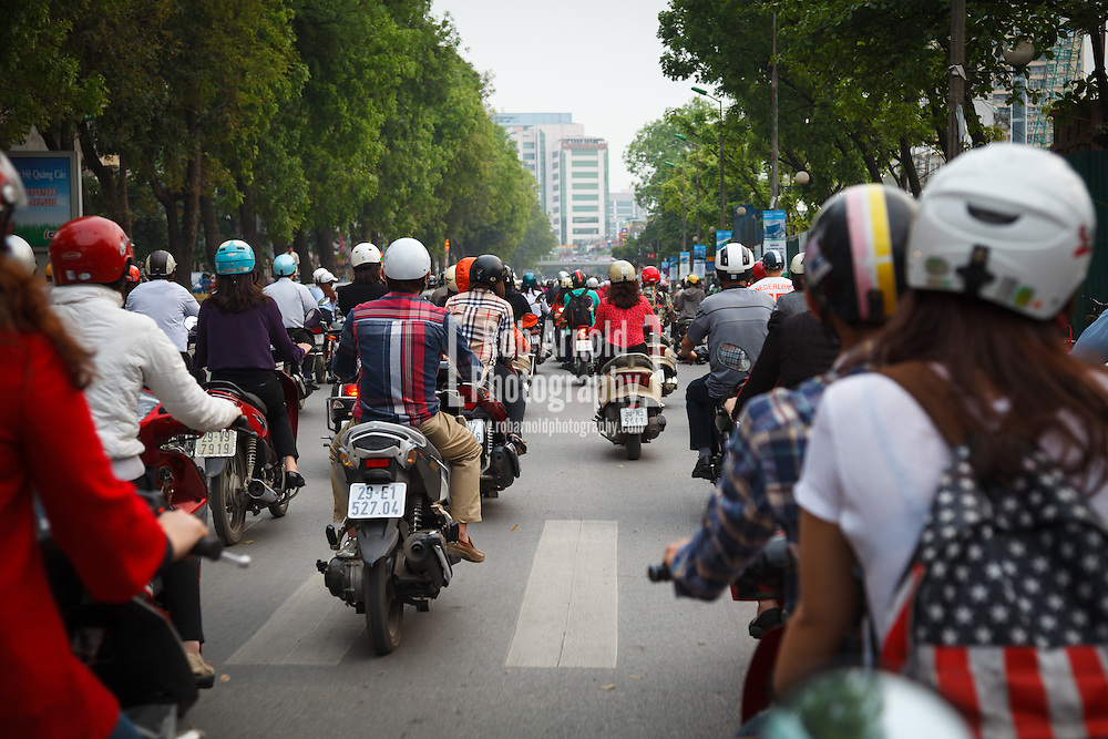 15/04/2013, Hanoi, Vietnam. A view from a scooter at rush hour in Hanoi, Vietnam. Scooters have become the choice of transport for people living in the city.
