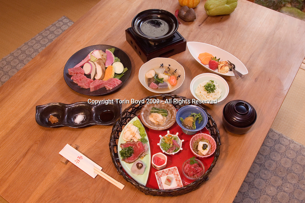 "This is Awa, a traditional kaiseki style Japanese restaurant located in the old Naramachi quarter of Nara, the ancient Japanese city that's celebrating it's 1300th anniversary in 2010. Seen here is the ""Yamato Gyu to Yasai"" dinner course (Yamato beef and vegetables) which features 12 dishes for 5000 Japanese yen (about $60 USD). This cozy eatery situated in an old Japanese townhouse with an interior courtyard serves up traditional fare using seasonal ingredients some even splashed with a hint of non Japanese recipes like Italian and Korean flavors. In addition to Yamato-gyu, the local beef from the Nara area they also serve chicken dishes, as well as fresh vegetables grown by the owners. Kaiseki or kaiseki ryori is a traditional multi-course Japanese dinner that is both a gastronomic and visual delight. Photo taken Dec. 16, 2009. Awa tel: 0742-24-5699, website kiyosumi.jp/awa/awa-naramachi (Japanese only)."