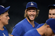 PHOENIX, AZ - AUGUST 10:  Clayton Kershaw #22 of the Los Angeles Dodgers smiles during batting practice for the MLB game against the Arizona Diamondbacks at Chase Field on August 10, 2017 in Phoenix, Arizona.  (Photo by Jennifer Stewart/Getty Images)