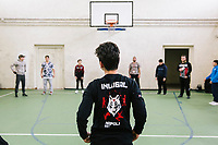 """NAPLES, ITALY - 16 MARCH 2018: Teenagers are seen here during a warm-up session before a parkour class at """"Il Tappeto di Iqbal"""" (Iqbal's carpet), a non-profit cooperative in Barra, the estern district of Naples, Italy, on March 16th 2018.<br /> <br /> Il Tappeto di Iqbal (Iqbal's Carpet) is a non-profit cooperative founded in 2015 and Save The Children partner since 2015 that operates in the Naple's eastern neighborhood of Barra children in the arts of circus, theater and parkour. It was named after Iqbal Masih, a Pakistani boy who escaped from life as a child slave and became an activist against bonded labor in the 1990s.<br /> Barra, which is home to some 45,000 people, has the highest rate of school dropouts in the Italian region of Campania. Once a thriving industrial community, many of the factories were destroyed in a 1980 earthquake and never rebuilt. The resulting de-industrialization turned Barra into a poor, decaying neighborhood. There are no cinemas, theaters, parks or public spaces in Barra.<br /> The vast majority of children from poor families are faced with the choice of working in the black economy or joining the ranks of the organised crime.<br /> Recently, Save the Children Italy opened a number of educational and social spaces in Barra. The centers, known as Punti Luce, or points of light, aim to help local kids stay out of the ranks of the organised crime and have also become hubs for Iqbal's Carpet to work."""