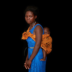 Portrait of child bride and mother Tisate Banda, 15, with her 5-month- old daughter.<br />
