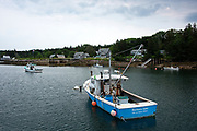 Fishing boats in the harbor of Isle au Haut, Maine.