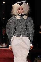 Liu Xu walks the runway wearing Thom Browne Fall 2014 Collection, <br /> Thom Browne (Designer)<br /> Jimmy Paul (Hair Stylist)<br /> Sil Bruinsma (Makeup Artist)<br /> Edward Kim (Casting Director)<br /> Julie Kandalec (Manicurist)