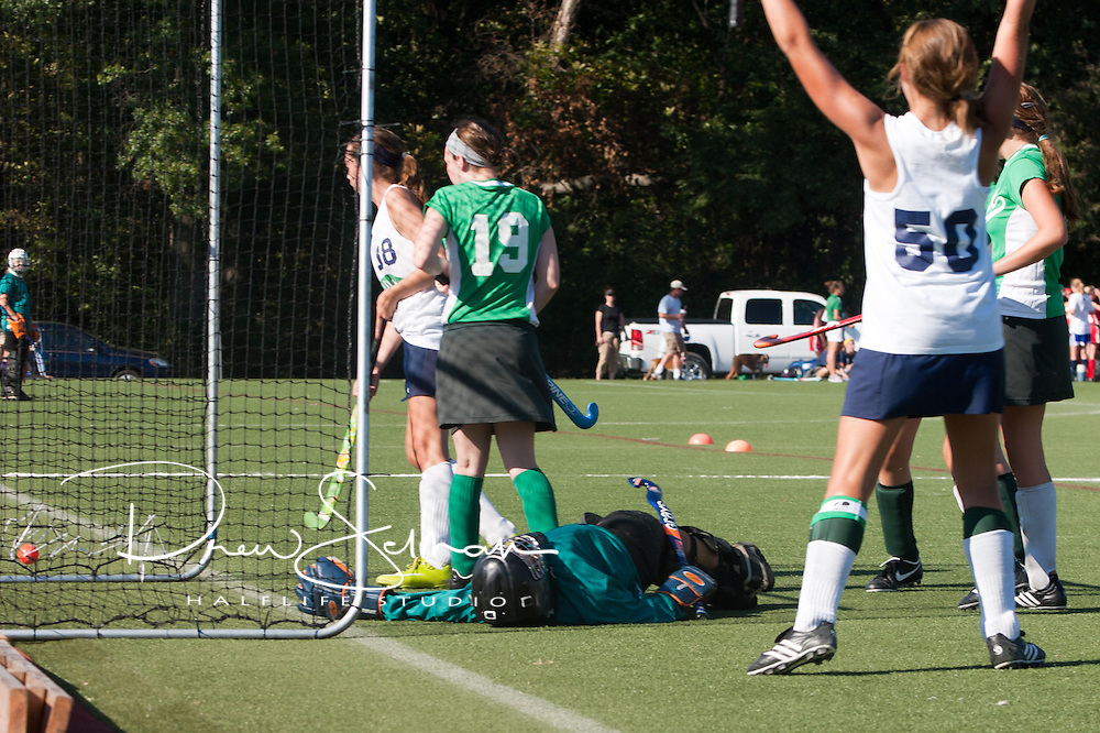 6 SEP 2010 -- FENTON, Mo. -- Marquette High School  field hockey player, Suzanne Sterns (38) beats the Nerinx Hall Academy Green goalkeeper as Captain Kylie Heyer (50) celebrates as Marquette ties the game  during the Gateway Field Hockey Labor Day Tournament at the A-B Center in Fenton, Mo., Monday Sept. 6, 2010.  The match ended tied 2-2.