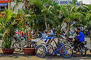 Three-wheel bicycle taxi, Cyclo, driver relaxing near Cho Ben Thanh Market