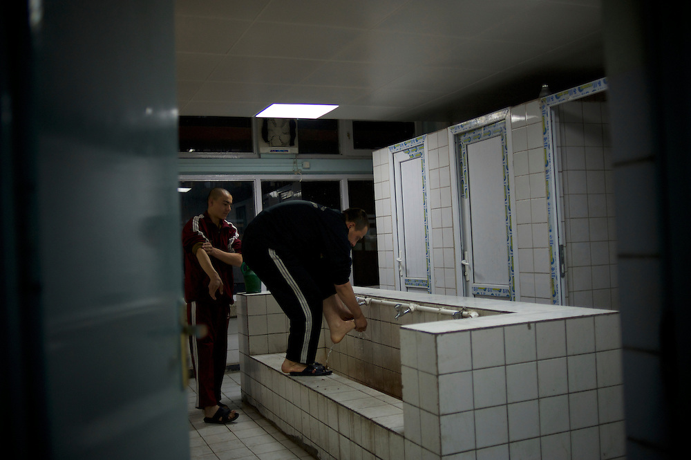 Afghan National Police (ANP) cadets wash their feet before praying time in the early hours of the morning at the Afghan Nacional Police Academy in Kabul.