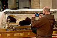 Rome, Italy. 3th Febraury 2016<br /> Pictured: Friar photographs the relic of St. Leopold Mandic<br /> The relic of St. Leopold Mandic, from Padua in the Basilica of San Lorenzo Fuori le mura awaiting the arrival of St. Pio of Pietrelcina. The two Saints were called to Rome by Pope Francis as symbols of the Mercy Jubilee.