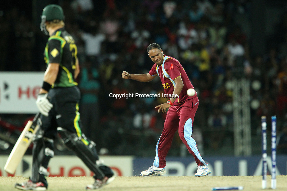 Samuel Badree of The West Indies celebrates the wicket of Shane Watson during the ICC World Twenty20 semi final match between Australia and The West Indies held at the Premadasa Stadium in Colombo, Sri Lanka on the 5th October 2012<br /> <br /> Photo by Ron Gaunt/SPORTZPICS