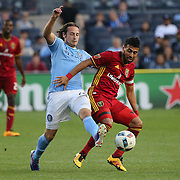 NEW YORK, NEW YORK - June 02: Mix Diskerud #10 of New York City FC is challenged by Javier Morales #11 of Real Salt Lake during the NYCFC Vs Real Salt Lake regular season MLS game at Yankee Stadium on June 02, 2016 in New York City. (Photo by Tim Clayton/Corbis via Getty Images)