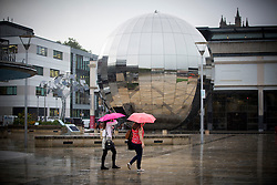 © Licensed to London News Pictures. 13/09/16. People brave the wet stormy weather in Bristol. Today is suspected to be the hottest September day ever as temperatures are set to soar to a scorching 32C. Photo credit should read Brad Wakefield/LNP