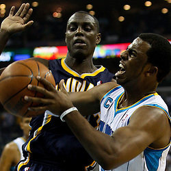 April 3, 2011; New Orleans, LA, USA; New Orleans Hornets point guard Chris Paul (3) drives past Indiana Pacers point guard Darren Collison (2) during the first quarter at the New Orleans Arena.    Mandatory Credit: Derick E. Hingle