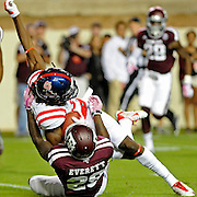 Texas A&M defensive back Deshazor Everett (29) tackles Mississippi wide receiver Quincy Adeboyejo (8) during the first half of an NCAA college football game in College Station, Texas, Saturday, Oct. 11, 2014. (Photo/Thomas Graning)