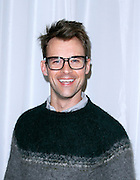 Brad Goreski poses backstage at Christian Siriano during the Mercedes-Benz Fall/Winter 2015 shows at Artbeam in New York City, New York on February 14, 2015.