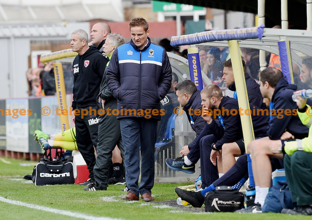 Wimbledon manager Neal Ardley looks concerned in the first half during the Sky Bet League 2 match between AFC Wimbledon and Morecambe at the Cherry Red Records Stadium in Kingston. October 17, 2015.<br /> Simon  Dack / Telephoto Images<br /> +44 7967 642437