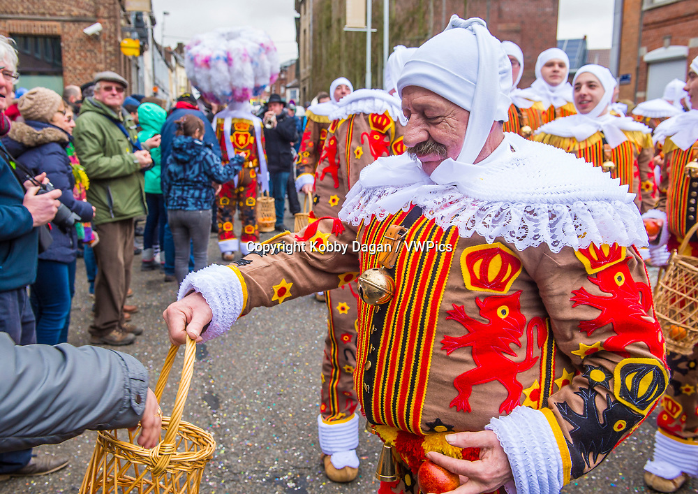 Participants in the Binche Carnival in Binche, Belgium. The Binche carnival is included in a list of intangible heritage by UNESCO.