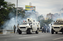 Bolivarian National Guard personnel fire tear gas at protesters who were going to the headquarters of the Tribunal Supremo De Justicia this May 3, 2017 on the Francisco Fajardo motorway.