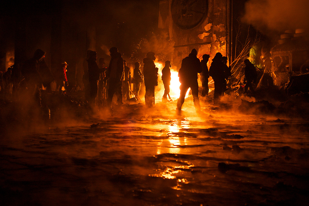 January 24, 2014 - Kiev, Ukraine: Protestors stand guard near a defensive barricade near Dynamo Kiev's stadium in central Kiev. (Paulo Nunes dos Santos)