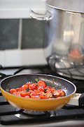 Cooking tomatoes in a frying pan