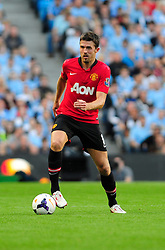 Manchester United's Michael Carrick - Photo mandatory by-line: Dougie Allward/JMP - Tel: Mobile: 07966 386802 22/09/2013 - SPORT - FOOTBALL - City of Manchester Stadium - Manchester - Manchester City V Manchester United - Barclays Premier League