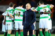 Yeovil Town manager Darren Way walks off the pitch as his players hug ready for the penalty shoot-out during the The FA Cup Third Round Replay match between Yeovil Town and Carlisle United at Huish Park, Yeovil, England on 19 January 2016. Photo by Graham Hunt.