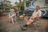 "Centralia ,Washington residents Angie and Earl Neuert with their dog, Summer, at the Calistoga RV Park.  ""We just spent the winter down south...Florida, Alabama, Arkansas...but we liked Texas the best...they had the lowest cost of living.""  -Earl Neuert"