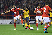 Arsenal midfielder Jeff Reine-Adelaide (31) battles for possession with Nottingham Forest midfielder Pajtim Kasami (22) and Nottingham Forest midfielder Chris Cohen (8) during the EFL Cup match between Nottingham Forest and Arsenal at the City Ground, Nottingham, England on 20 September 2016. Photo by Jon Hobley.