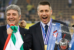 Coach  of Trentino Radostin Stoytchev (R) celebrates with a Trophy at final ceremony after the  final match of CEV Indesit Champions League FINAL FOUR tournament between Dinamo Moscow, RUS and Trentino BetClic, ITA on May 2, 2010, at Arena Atlas, Lodz, Poland. Trentino defeated Dinamo 3-0 and became Winner of the Champions League. (Photo by Vid Ponikvar / Sportida)